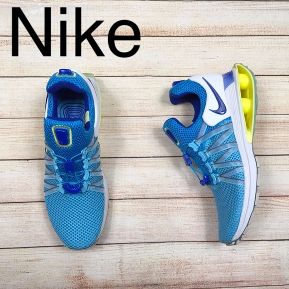 wholesale dealer 9501c 1d65a NEW Nike Shox Gravity in blue and yellow. M 5c885497534ef9a3ae24909b